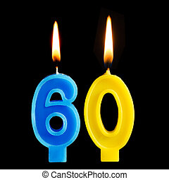 Burning birthday candles in the form of 60 sixty figures for...