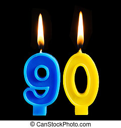 Burning birthday candles in the form of 90 ninety figures...