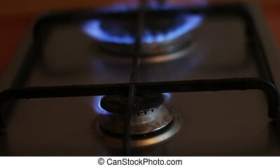 Burning blue flames of a gas stove