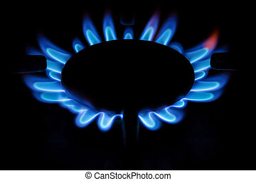 Burning blue gas on the stove.