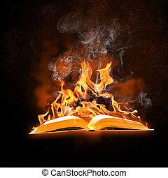 Burning book - Image of opened burning book against black...