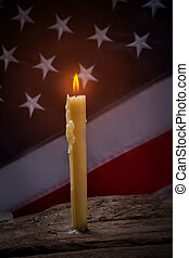 Burning candle and american flag.