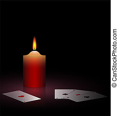 burning candle and cards - on a black background are burning...
