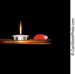 burning candle and red petal - the burning candle on the...