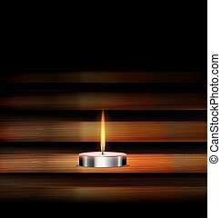 burning candle and wood - dark background and burning candle...