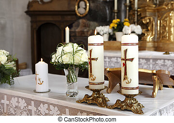Burning candle at the communion