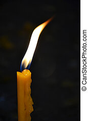 Burning candle in a church