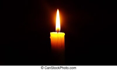 burning candle in the dark, a symbol of sorrow for the dead. High quality 4k footage