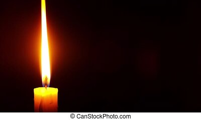 burning candle in the dark with copy space, a symbol of sorrow for the dead . High quality 4k footage