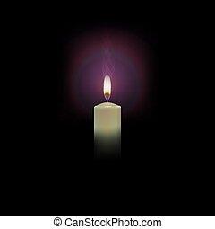 burning candle on a black background with a haze - burning...