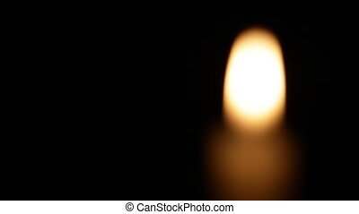 Burning candle on black background - Burning candle on dark...