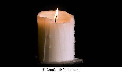 Burning candle on black - Burning candle isolated on black...