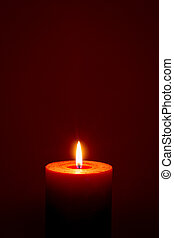 burning candle on dark red background