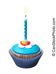 Burning candle on the cupcakes with decorations of mastic