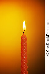 Burning Candle - burning wax candle on a yellow background