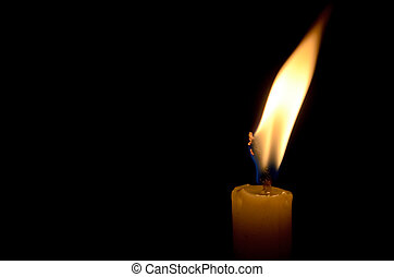 Burning Candle - A single burning candle in the dark