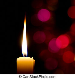 Burning candle on abstract color bacground