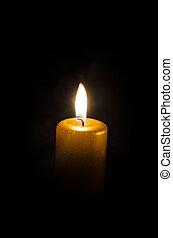 burning candle - one burning candle decoration against black...