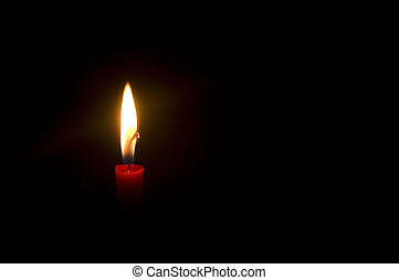 burning candle - a burning candle in darkness, with copy...