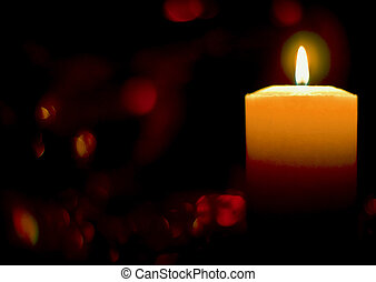 burning candle on a background of diffuse reflections