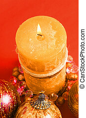 Burning candle in rich warm tones