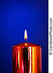 Burning Candle - burning wax candle on a blue background