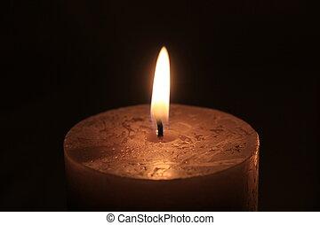 Burning candle - Closeup of a big burning candle , dark...