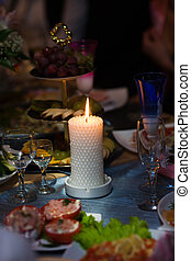 burning candle - Beautiful burning candle at dinner table...