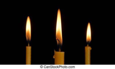 Burning Candle With Black Background.