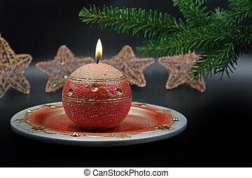 Burning candle with christmas decoration on background