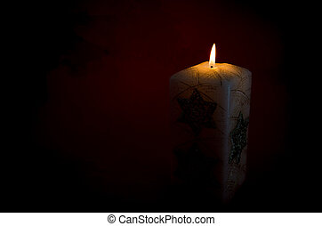 burning candle with dark background