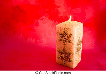 burning candle with red background