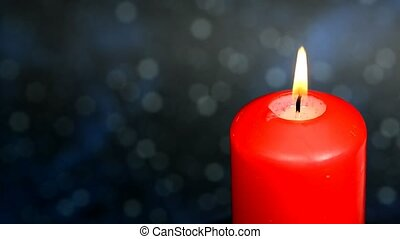 burning candle with zoom in of a star sky