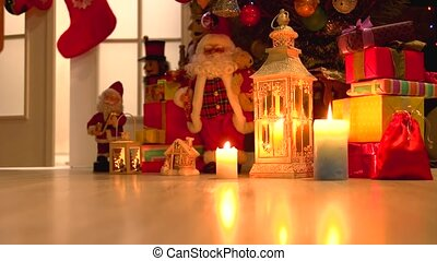 Burning candles and Christmas decorations. Lantern with a...