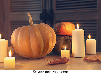 Burning candles and pumpkins