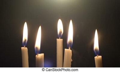 Burning candles and smoke close-up