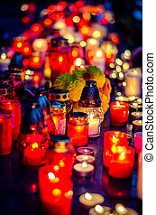 burning candles at the cemetery