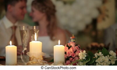 burning candles at  wedding table