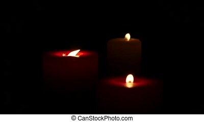 Burning candles black background, Close up. Slow motion -...