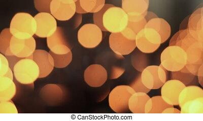 Burning candles. Blurred image.