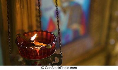 Burning candles, colourfull slow motion