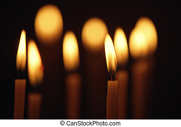 Burning candles - Discounted wax candles in the church....