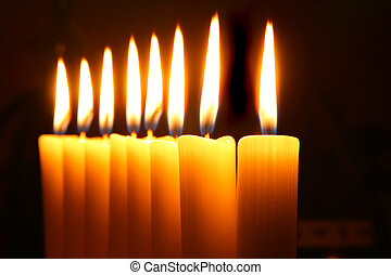 Burning candles - Eight burning candles over black...