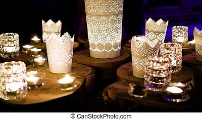 burning candles in a dark room. romantic evening