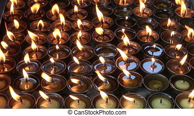 Burning candles in Buddhist temple,