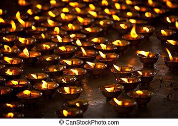 Burning candles in Buddhist temple. Tsuglagkhang complex, McLeod Ganj, Himachal Pradesh, India