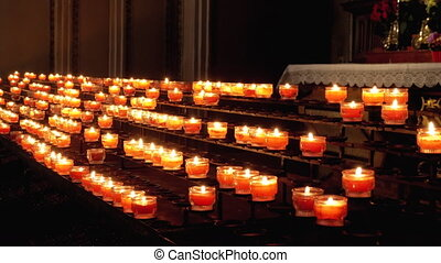 Burning Candles in Cathedral. Burning Memorial Candles in...