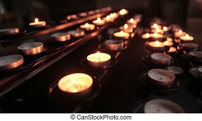 Lighted Candles In The Temple In The Twilight. Burning...