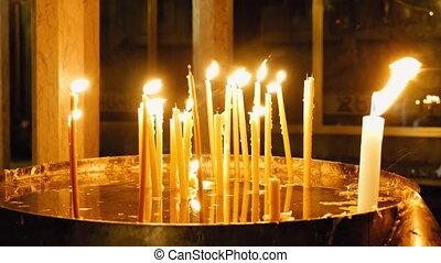 Burning candles in Holy Sepulcher Church - Jerusalem, Israel...