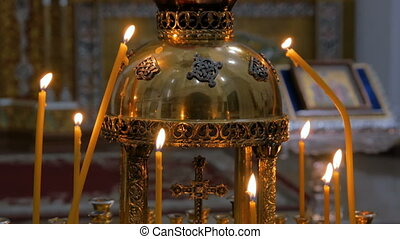 Burning candles in russian orthodox church. Religion and...